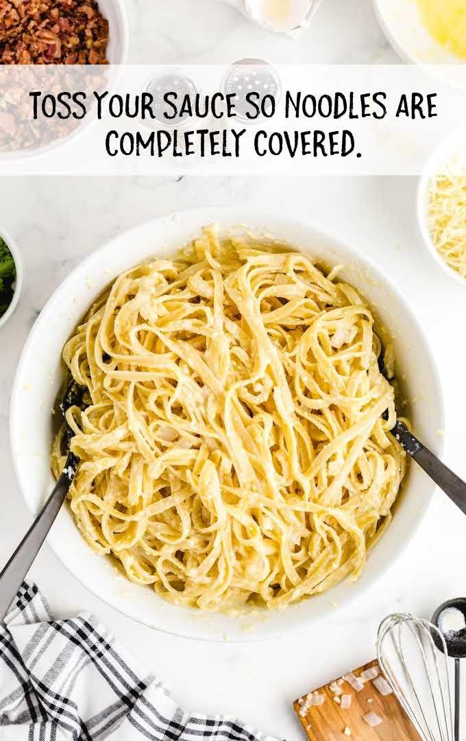 carbonara pasta process sauce of noodles in a bowl