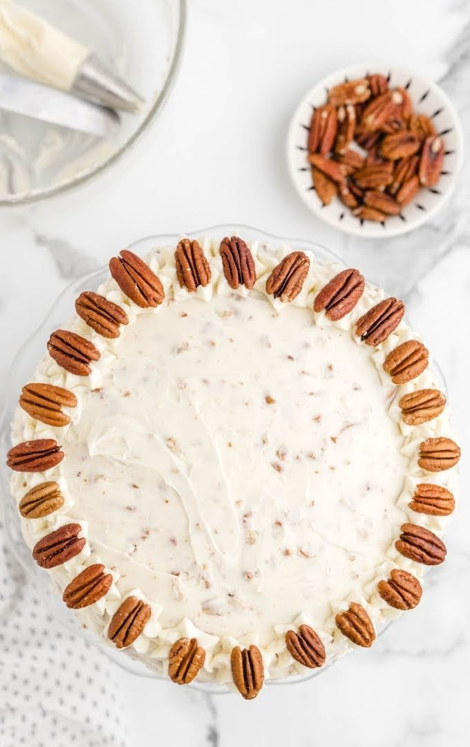 overhead shot of carrot cake cheesecake with pecans on top