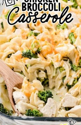 close up shot of chicken broccoli casserole in a baking dish with a wooden spoon