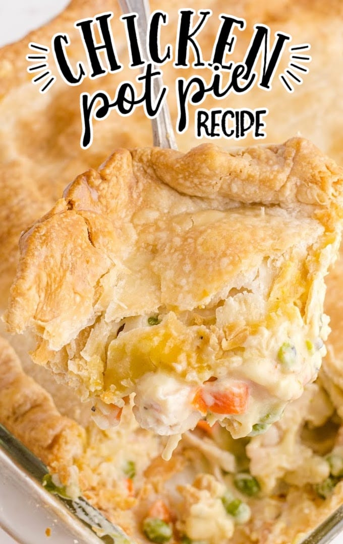 close up overhead shot of chicken pot pie bake in a clear dish being picked up with a spoon