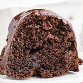 close up shot of a slice of Chocolate Brownie Cake on a plate