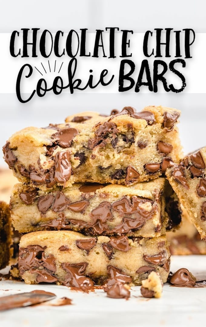 chocolate chip cookie bars stacked on top of each other with chocolate chips melting