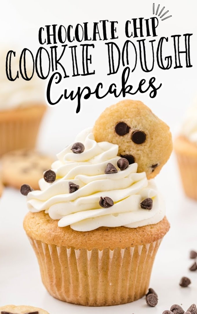 close up shot of cookie dough cupcakes topped with whipped cream frosting and a mini chocolate chip cookie