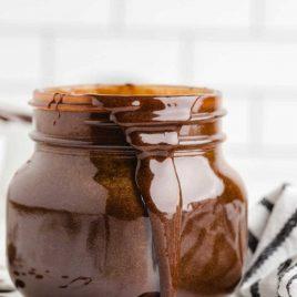 close up shot of Hot Fudge Sauce in a glass jar