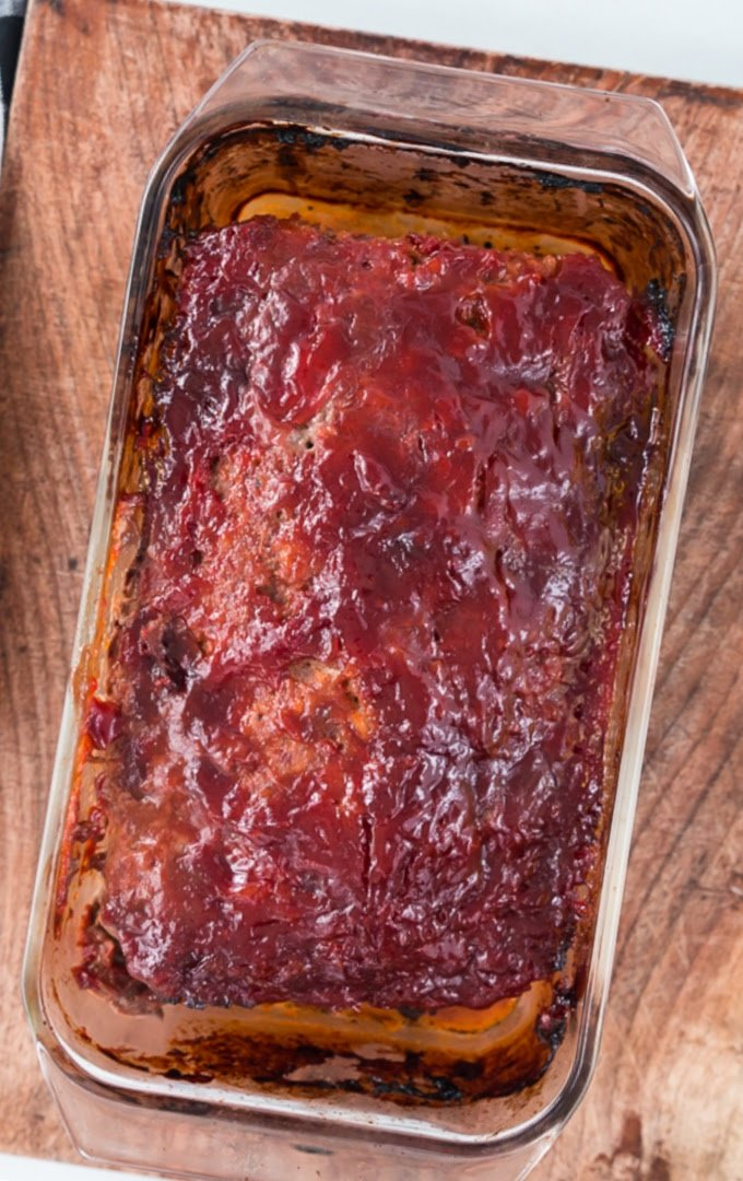 close up overhead shot of meatloaf in a dish