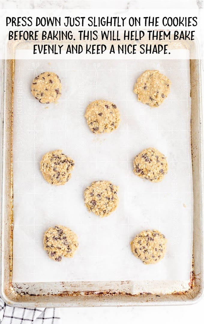 oatmeal chocolate chip cookies process shot of cookies on a baking sheet