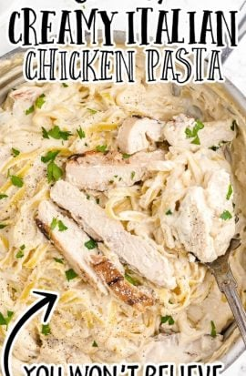 overhead shot of creamy Italian chicken with pasta in a dish being picked up with a fork