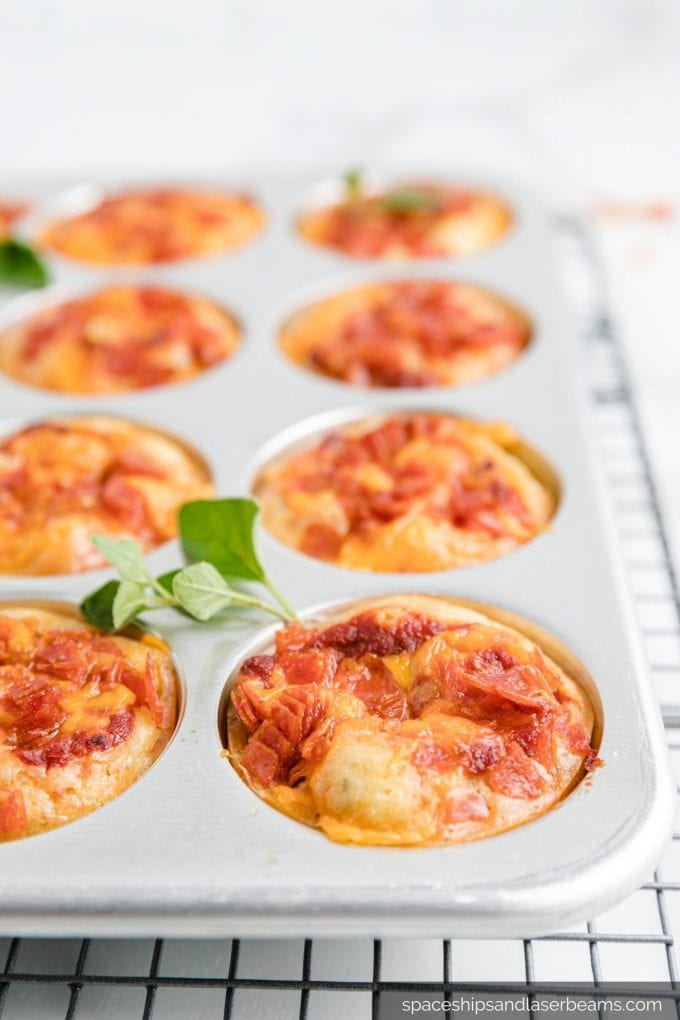 close up shot of pizza muffins in a muffin pan