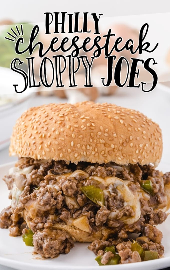 Philly cheesesteak sloppy joes oozing out on a white plate