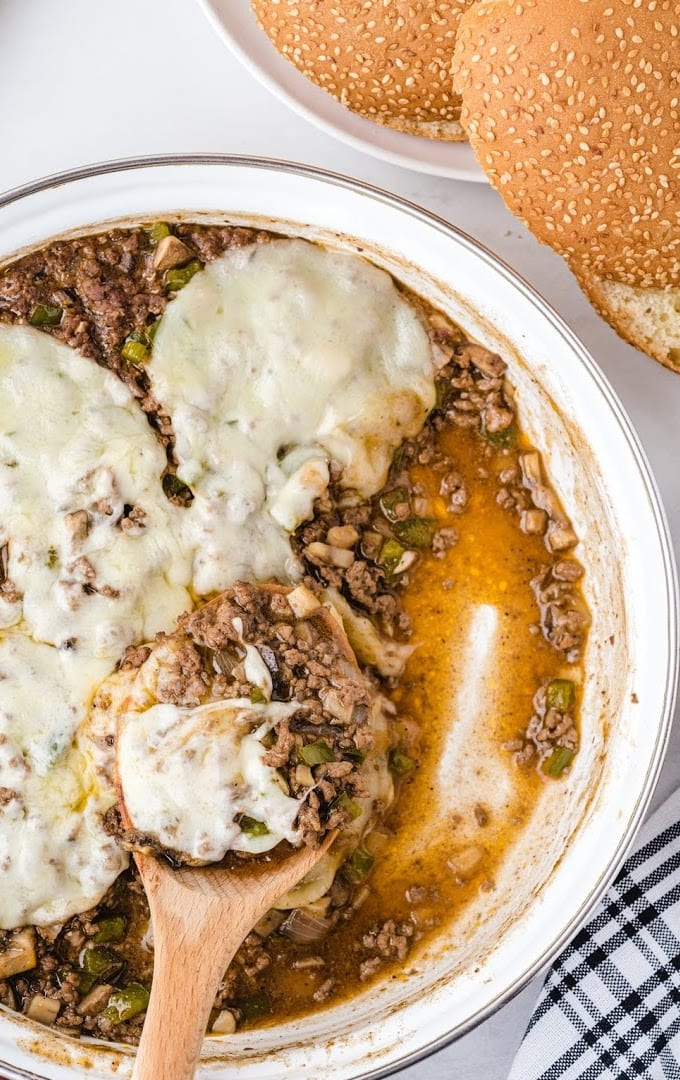 overhead shot of Philly cheesesteak sloppy joes in a dish