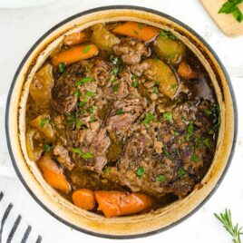close up overhead shot of a pot of Pot Roast garnished with parsley