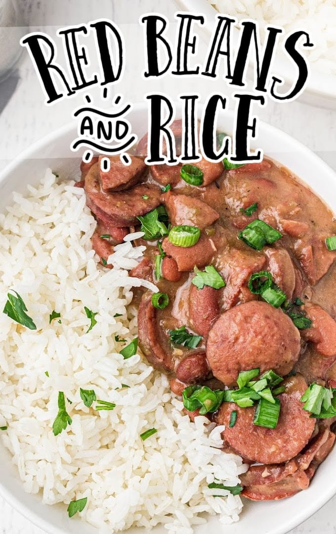 close up overhead shot of red beans and rice garnished with green onions in a white bowl