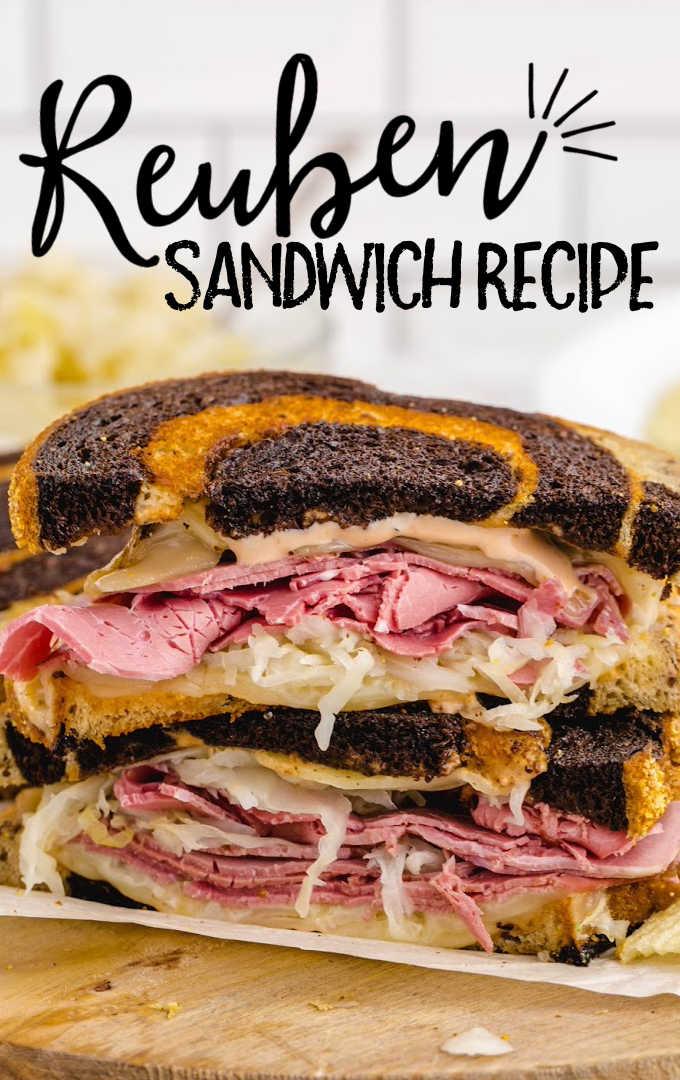 close up side shot of reuben sandwich on a wooden board