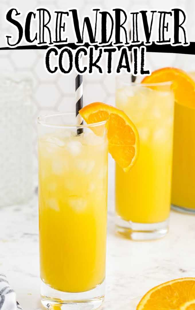 side shot of screwdriver cocktail in a glass cup served with a slice of orange and a straw