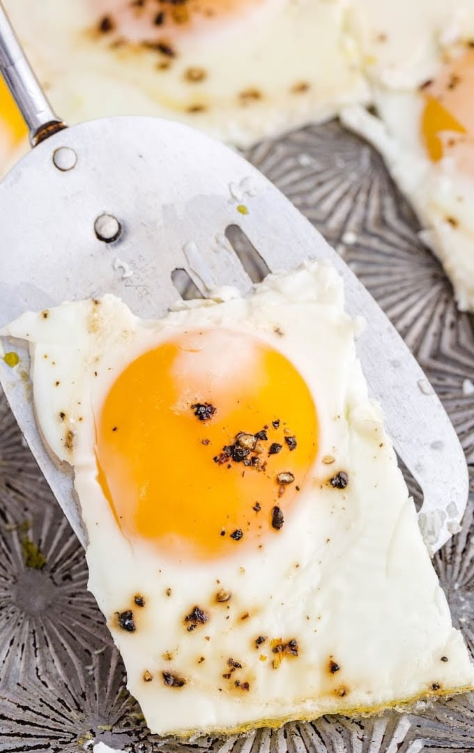 close up shot of a piece of sheet pan eggs on a spatula