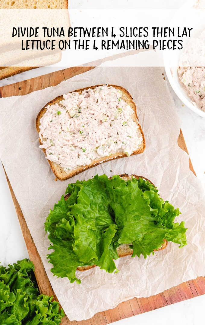 tuna sandwich process shot of tuna and lettuce layer on the bread