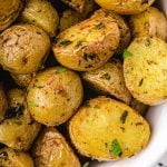 close up overhead shot of garnished oven roasted potatoes