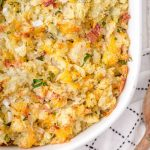 close up overhead shot of twice baked potato casserole in a white dish