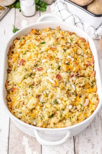 twice baked potato casserole in a white serving dish