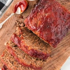 close up overhead shot of slices of meatloaf on a wooden board