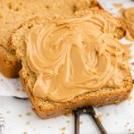 close up of peanut butter bread with peanut butter spread on
