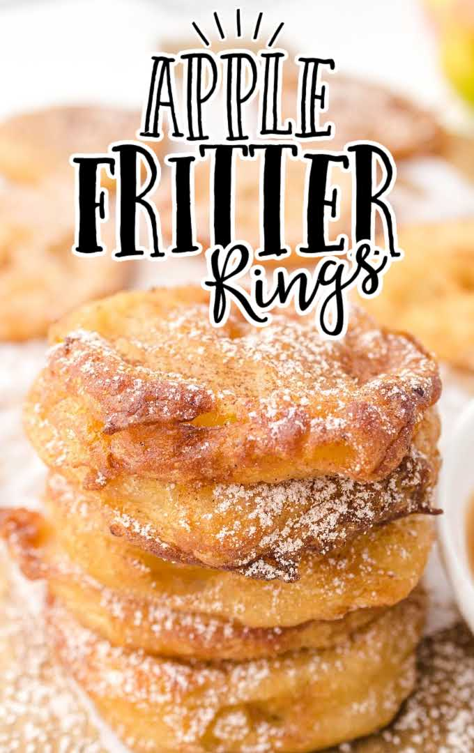 apple fritter rings stacked on top of each other and drizzled with powder sugar