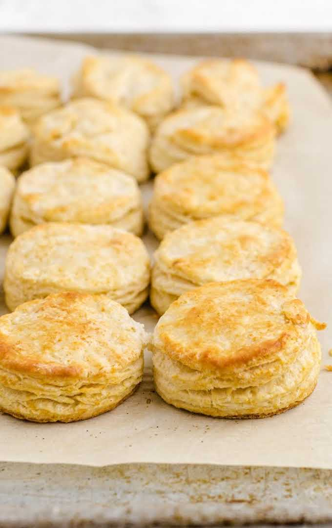 buttermilk biscuits lined on a baking tray