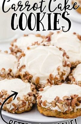 close up shot of carrot cake cookies with cream cheese frosting piled on a white plate