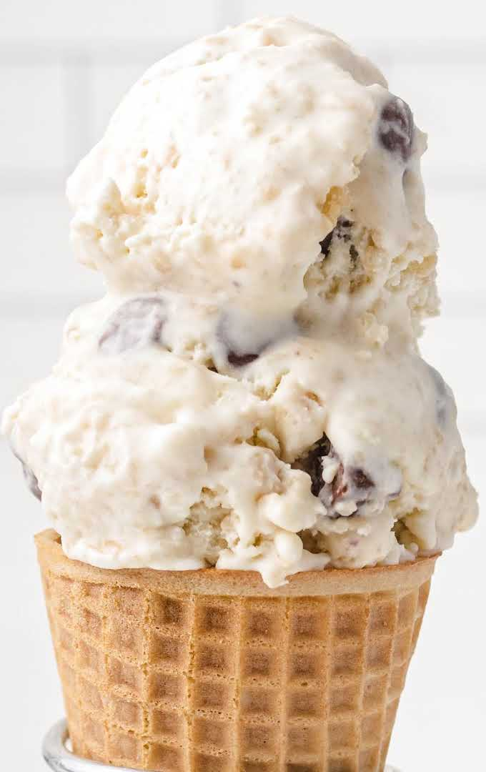 close up shot of scoops of cookie dough ice cream in a waffle cone