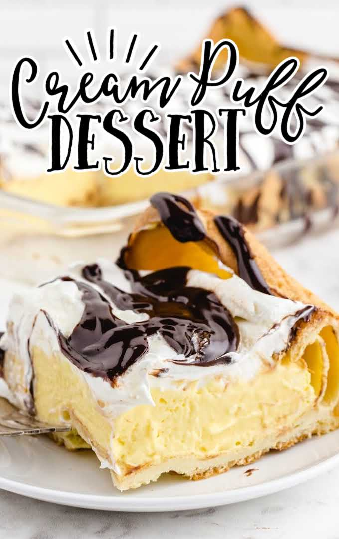a slice of cream puff dessert drizzled with hot fudge sauce on a white plate with a fork