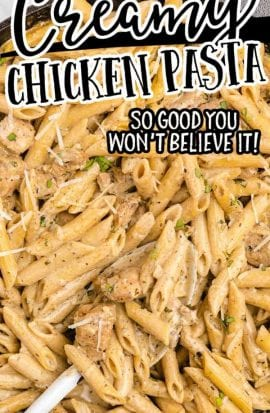 close up overhead shot of creamy chicken pasta in a pan with a spoon