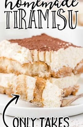 close up side shot of a slice of easy tiramisu recipe on a plate with a piece taken out with a fork