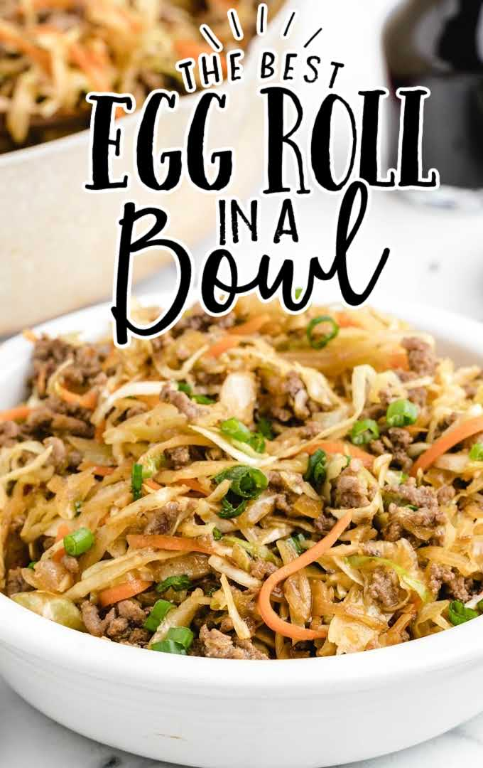close up shot of egg roll in a bowl garnished with green onions in a white bowl