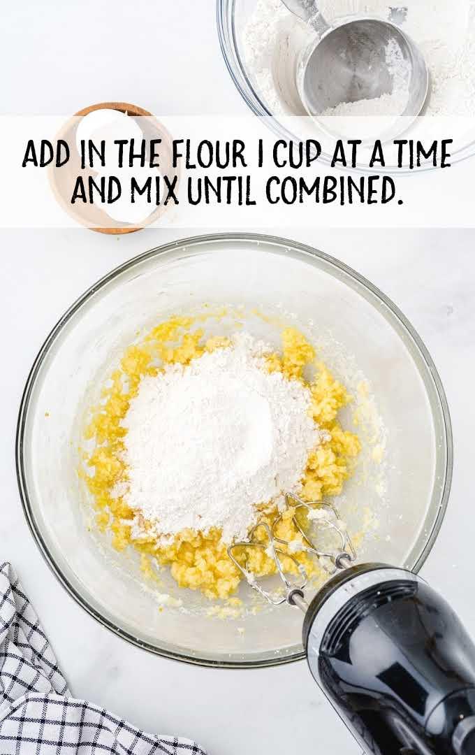 lemon crinkle cookies process shot of ingredients being blended in a bowl