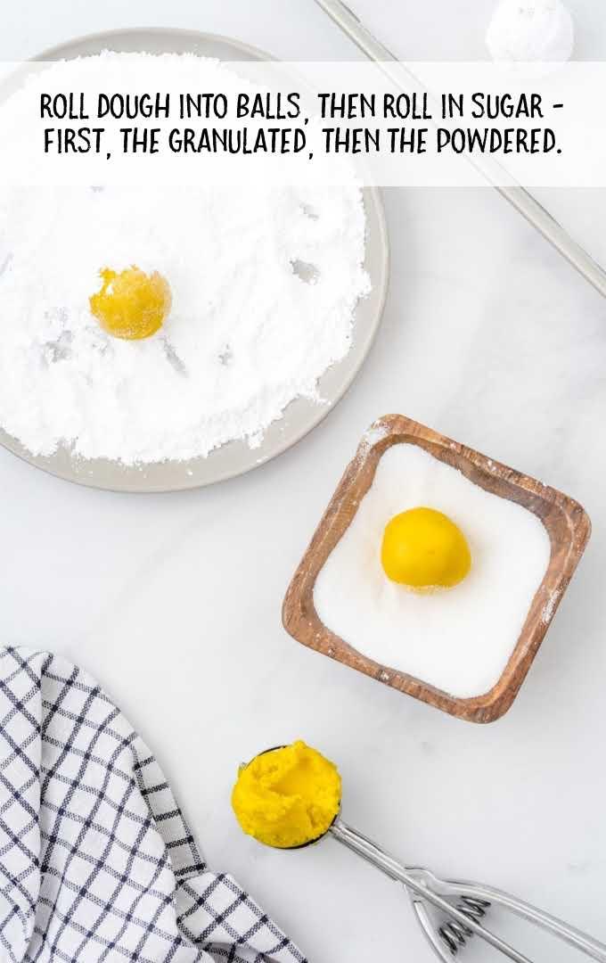 lemon crinkle cookies process shot of dough balls rolled into sugar then powder