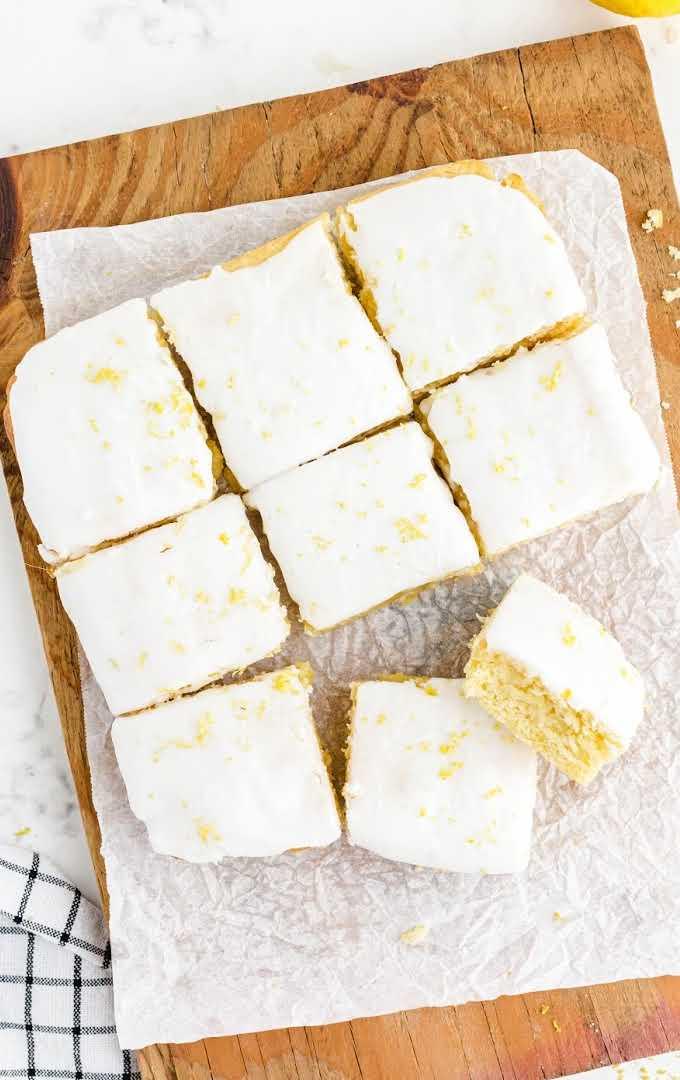 overhead shot of lemon brownies sliced on a white board