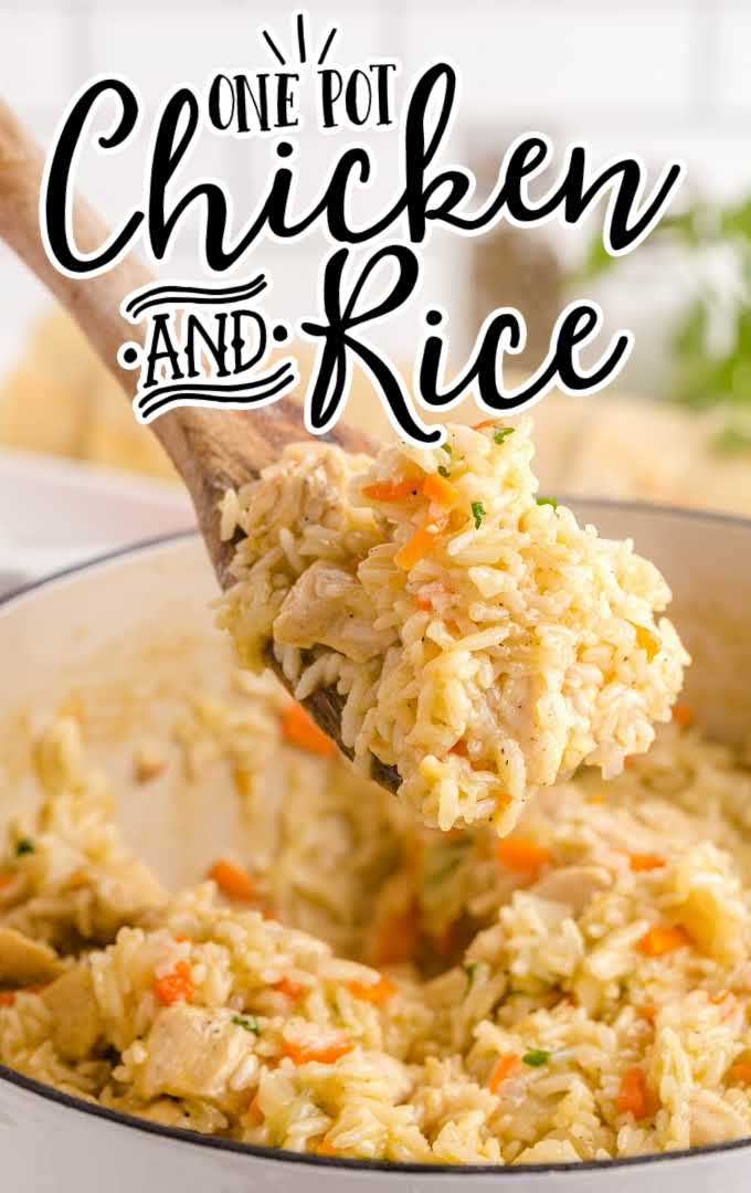 close up shot of one pot chicken and rice in a pan being picked up with a large wooden spoon