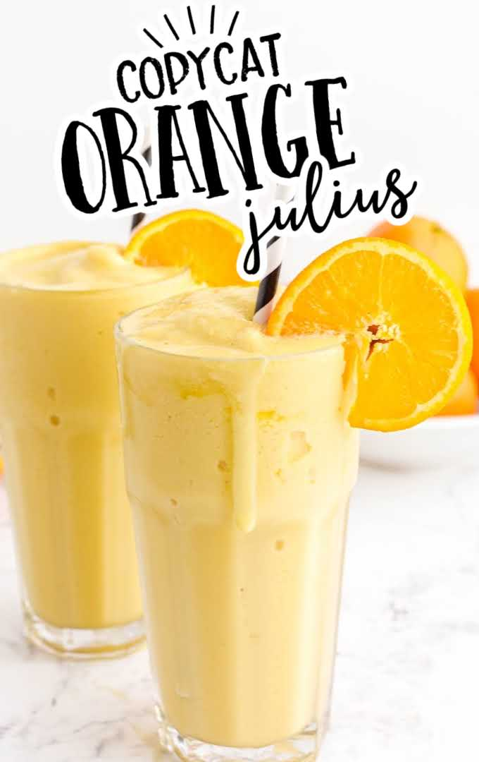 orange julius in glasses with a stripped straw garnished with a slice of orange