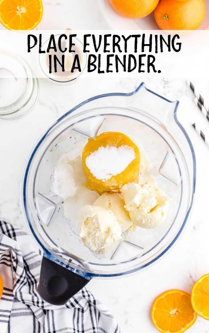 orange julius process shot of ingredient in a blender