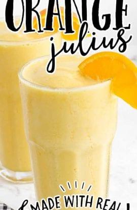 orange julius in glasses garnished with a slice of orange
