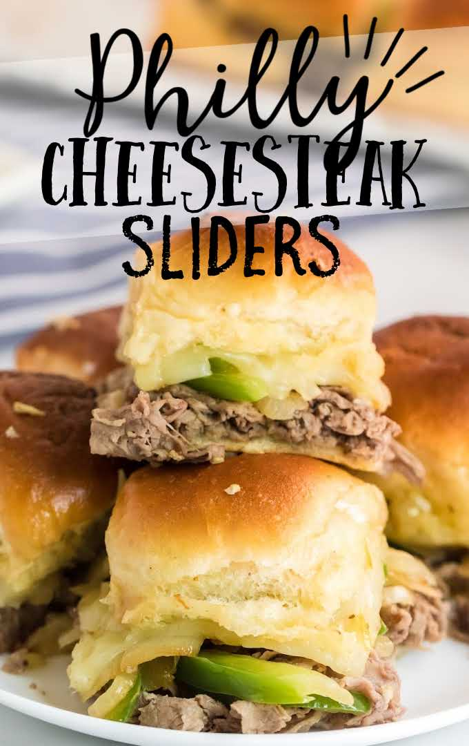 close up shot of Philly cheesesteak sliders stacked on top of each other on a white plate