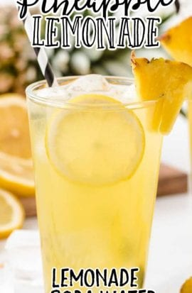 a glass of pineapple lemonade with ice and lemon and pineapple slices