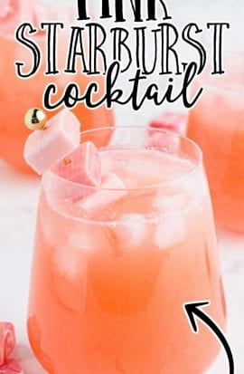 pink starburst cocktail with starburst candy in a glass