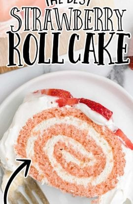 overhead shot of a slice of strawberry roll cake garnished with strawberries on a white plate with a fork