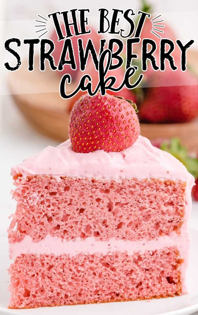 a slice of strawberry cake with a strawberry on top on a plate