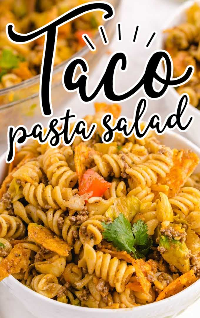 close up shot of taco pasta salad garnished with cilantro in a white bowl