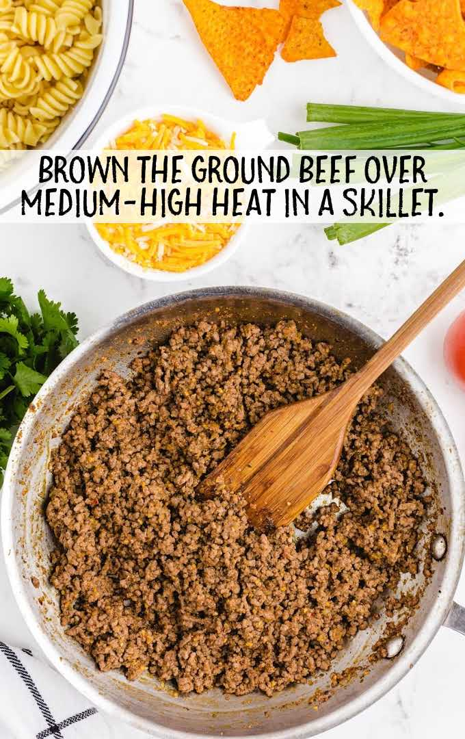 taco pasta salad process shot of ground beef being cooked in a skillet