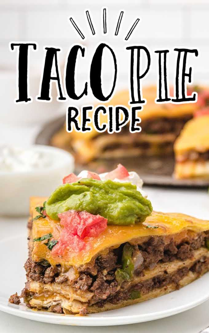Taco Pie topped with guacamole, cream cheese, and salsa on a plate