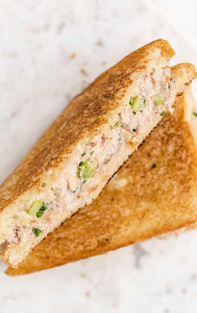 overhead shot of tuna melt sandwiches sliced in half