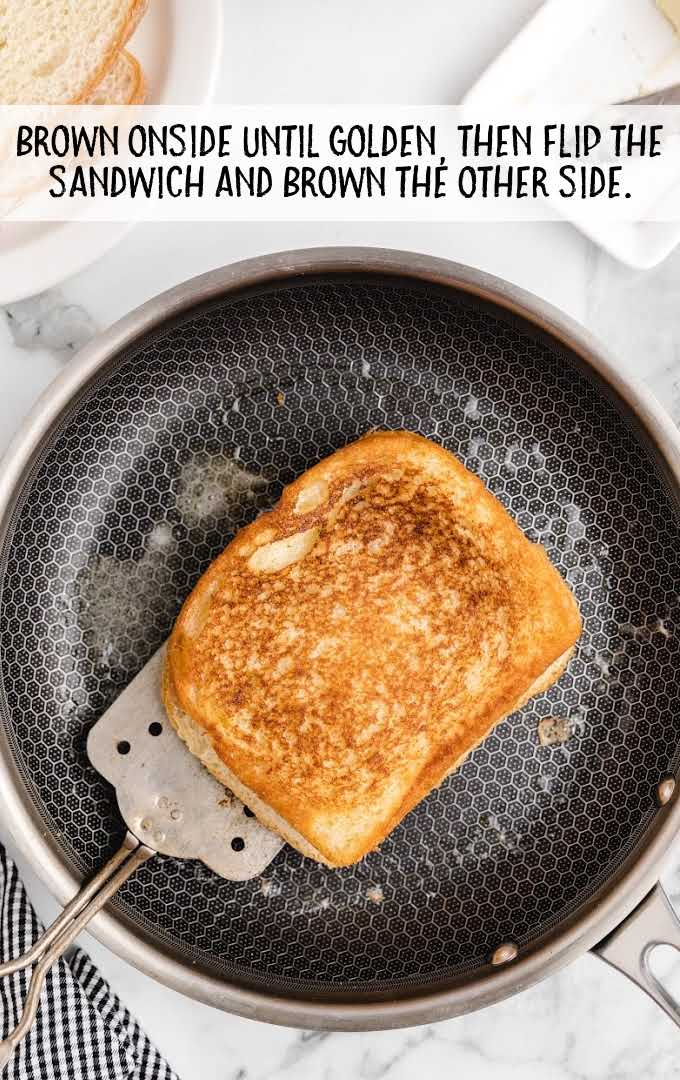 tuna melt process shot of sandwich on a skillet being cooked